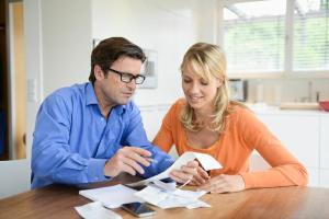 older couple reviewing financing over kitchen table